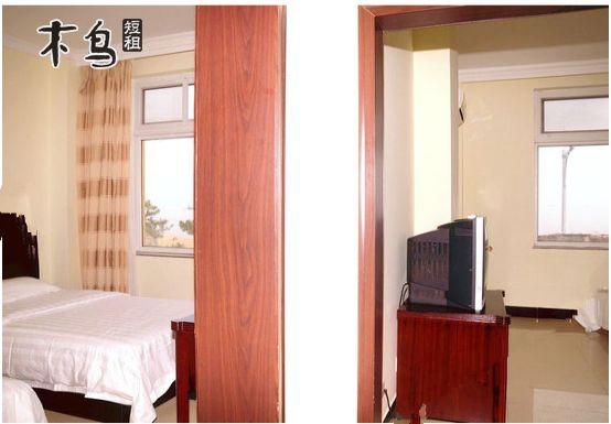 为两栋欧式建筑风格的楼房,拥有双人标准间,套间等客房,装修豪华,配套