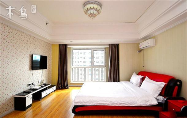 哈西万达公寓  红色榻榻米大床短租日租