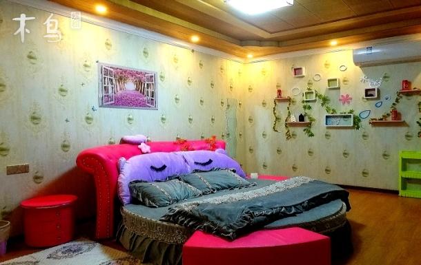 重庆江北机场附近嫣紫主题公寓圆床房