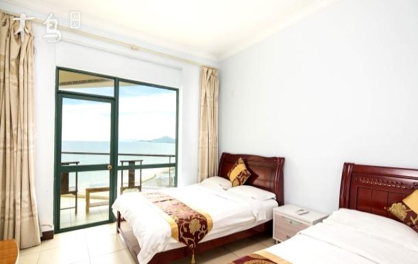 三亚湾巴哥海景公寓高层双大床房