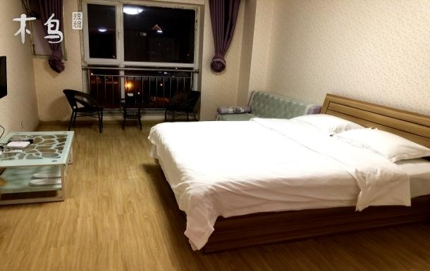 威海站旁东海岸繁华商圈一念之间自助舒适大床房、温馨家庭房